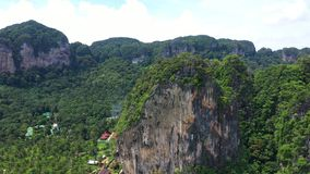 Close up on stunning limestone rocks in Krabi, Thailand. Aerial view of popular limestone mountains of Krabi Province, Thailand, Andaman sea.Stunning landscape stock footage