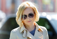 Close-up of stylish blond female model in sun glasses Royalty Free Stock Photo