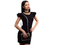 Close up stylish woman in black dress with small silver bag and choker. fashion concept Royalty Free Stock Photos