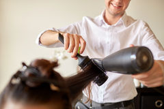 Close up of stylist making hairdo at salon Stock Photos