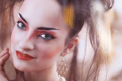 Close up stylized portrait of a Japanese geisha with bright make Stock Photos