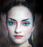 Close up stylized portrait of a Japanese geisha with bright make Royalty Free Stock Image