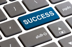 Close up success button on keyboard computer Stock Image