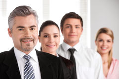 Close up of successful adult businessman leading business team. Royalty Free Stock Photography