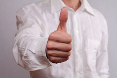 Close up of successful businessman manager giving thumbs up. Business success concept Stock Photo