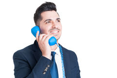 Close-up of successful happy businessman talking on retro phone Royalty Free Stock Photography