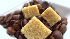 Close up of sugar cubes with coffee beans stock video