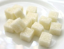 Closeup of sugar cubes on white plate Stock Images
