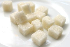 Closeup of sugar cubes on white plate Royalty Free Stock Photo