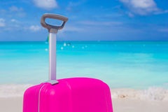 Close up suitcase against the turquoise ocean and blue sky Stock Image