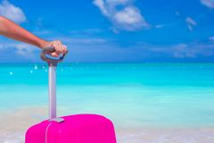 Close up suitcase against the turquoise ocean and blue sky Royalty Free Stock Photography