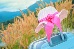 Close up suitcase with pink beach hat Stock Images