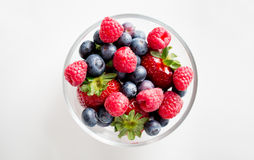 Close up of summer berries in glass bowl Royalty Free Stock Photos