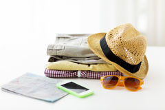 Close up of summer clothes and travel map on table Stock Photography