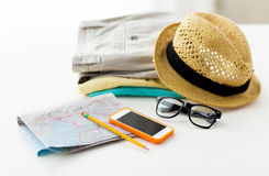 Close up of summer clothes and travel map on table Stock Photos