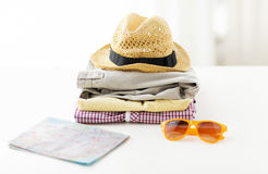 Close up of summer clothes and travel map on table Royalty Free Stock Image