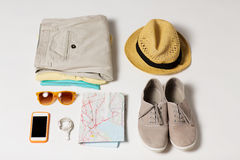 Close up of summer clothes and travel map on table Stock Image
