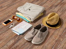 Close up of summer clothes and travel map on table Royalty Free Stock Images