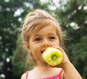 Close up summer portrait of Little girl eating pepper outdoor Stock Images