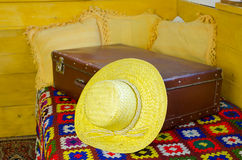 Close up of summer straw women hat on old suitcase Stock Photos