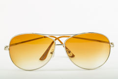 Close up Sun glasses on the table. With white background Stock Photos
