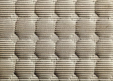 Bare Matress Abstract. Close-up on a sun-lit bare matress, featuring its texture and patterns Royalty Free Stock Photos