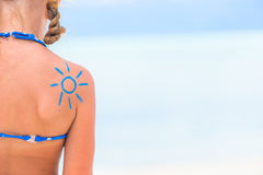 Close up sun painted by sun cream on kid shoulder Royalty Free Stock Photo
