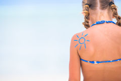 Close up sun painted by sun cream on kid shoulder Stock Photos