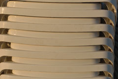 Close up of sunbeds on the beach stacked, ready to be put on the Stock Images