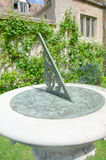 Close up of sundial with old house Royalty Free Stock Images