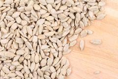 Close up of  sunflower seeds on wooden board Royalty Free Stock Images