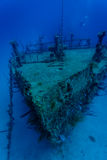 Close up of sunken wreck hull of boat off coast of Honduras and scuba diver Stock Image