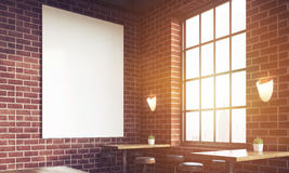 Close up of sunlit bar with poster and large windows Stock Images
