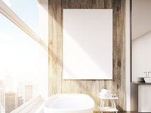 Close up of sunlit poster on bathroom wall Royalty Free Stock Photos