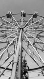 Black and white Ferris wheel Stock Images