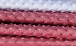 Close up surface of beautiful and colorful fashion textiles and fabrics stock image