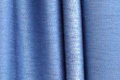 Close up surface of colorful fabrics cloth and textiles being folded and hang up in high resolution royalty free stock photo