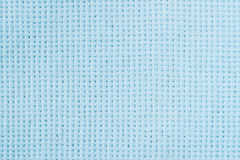 Close-up surface fabric pattern, light blue texture background. For background , backdrop, substrate, composition use. Close-up surface fabric pattern, light Stock Images