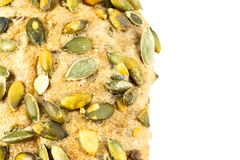 Close up of the surface of a german bread roll with pumpkin seed royalty free stock photos