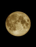Close up surface textured of yellow full moon. Unar on dark night sky, black space background Stock Image