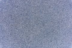 A close-up of a surface of treated grey granite rock plate. A fragment of a stone wall decoration. Texture of bright grey granite facing material stock photos