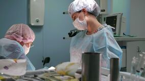 Close-up of surgeon. Doctors and assistants working in the operating room. Surgical team and honey nurse during a real