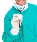 Close-up of surgeon holding a stethoscope Royalty Free Stock Photo