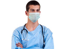 Close up surgeon wearing blue scrubs with arms crossed Stock Photography