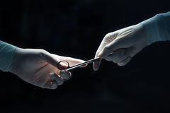 Close-up of surgeons hands hold equipment Stock Photography