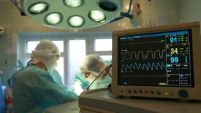 Close up of surgery team operating stock footage