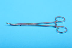 Close Up Surgical instruments and tools on blue mirror background. Selective focus. Royalty Free Stock Photo