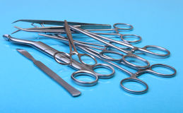 Close Up Surgical instruments and tools on blue mirror background. Selective focus. Royalty Free Stock Image