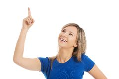 Close up surprised woman pointing to the corner Royalty Free Stock Photography