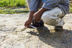 Close-up of a surveyor assistance measuring with measure tape Stock Photo